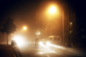 Vehicles and road in fog